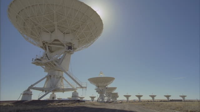 WS TU TD View of satellites dishes at Very Large Array and truck / San Augustine, New Mexico, USA