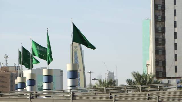 view of saudi flags fluttering in the breeze. - riyadh stock videos & royalty-free footage