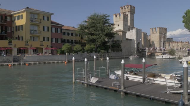 view of scaliger castle and boats in harbour, sirmione, lake garda, lombardy, italy, europe - circa 14th century stock videos & royalty-free footage