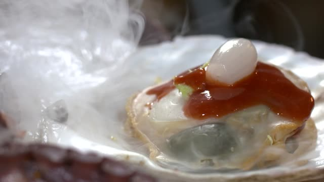 view of scallop with dry ice smoke - silver platter stock videos and b-roll footage
