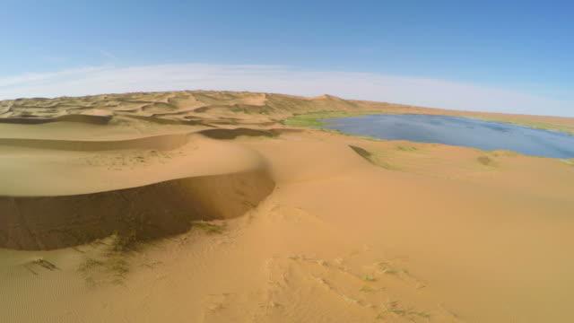 ws aerial view of scene of tengger desert/alashan, inner mongolia, china. - tengger stock videos & royalty-free footage