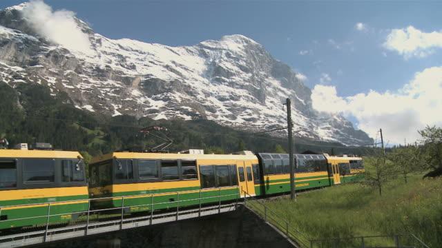 ws view of scheidegg railway at eiger mountain / grindelwald, bernese alps, switzerland - berner alpen stock-videos und b-roll-filmmaterial