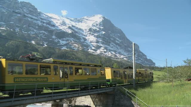 ws view of scheidegg railway with eiger mountain in background/ grindelwald, bernese alps, switzerland - berner alpen stock-videos und b-roll-filmmaterial