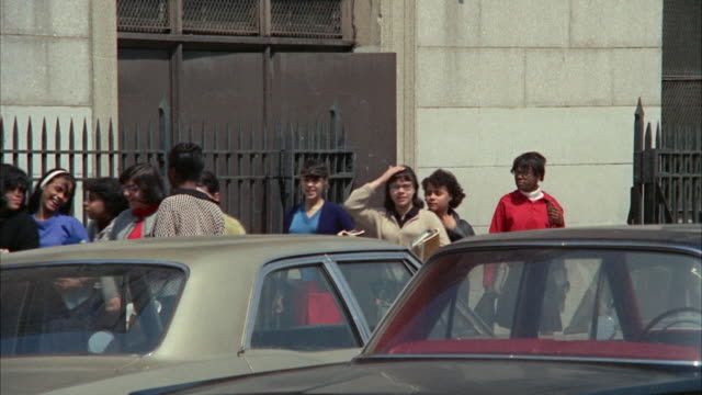 ms zo pan view of school students getting out of school building / new york city, new york, usa - 1966 stock videos & royalty-free footage