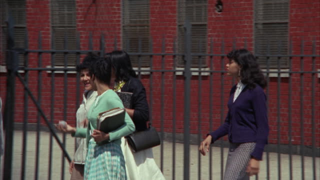 ms pan view of school students walking on pavement towards school / new york city, new york, usa - 1966 stock videos and b-roll footage