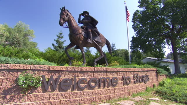 ws view of sculpture of rider on horse with words welcome to sturgis and american flag / sturgis, south dakota, united states - animal representation stock videos & royalty-free footage