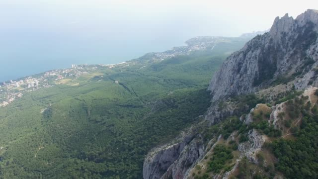 aerial: view of sea from mountain plateau - stone object stock videos & royalty-free footage