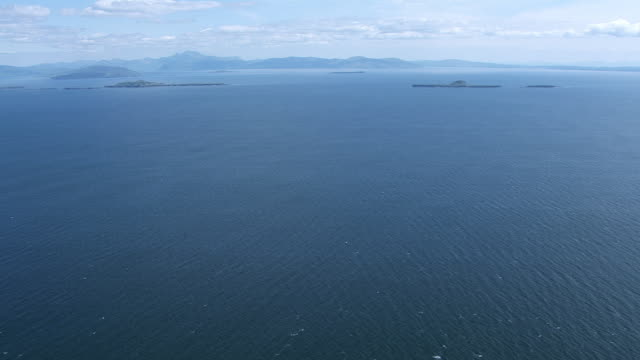 WS AERIAL TU View of sea in Hebrides on west coast heading towards isles / Isle or island of Mull and Treshnish, Isles Argyll and Bute, Scotland