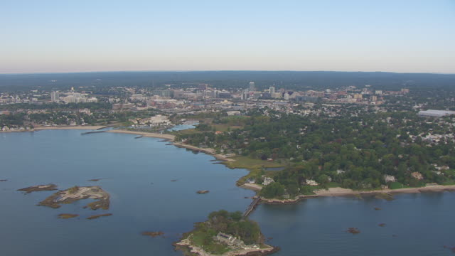Ws Aerial Pov View Of Sea With Greenaway Island And Westcott Cove Cityscape In Distance Stamford Connecticut United States Stock Video