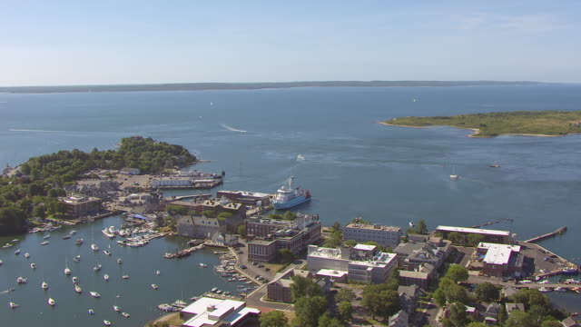 WS AERIAL POV View of sea with harbour and town / Falmouth, Massachusetts, United States