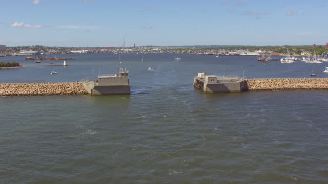 ws tu aerial pov view of sea with hurricane barrier, harbour in background / new bedford, massachusetts, united states - new bedford stock videos & royalty-free footage