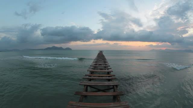 ws view of sea with jetty at playa de muro near alcudia / mallorca, balearic islands, spain  - バレアレス点の映像素材/bロール