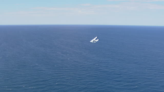MS AERIAL View of seaplane flying over / Kings Cliff, New South Wales, Australia