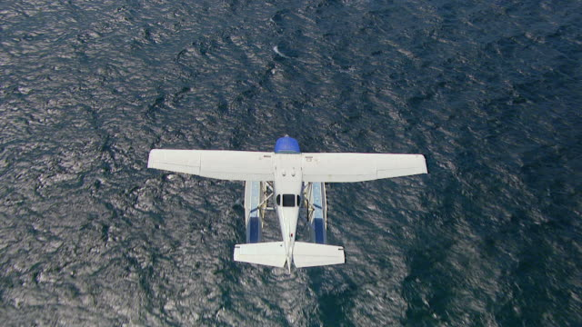 WS AERIAL TS View of seaplane flying over ocean / Kings Cliff, New South Wales, Australia