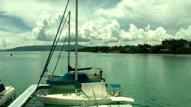 view of seascape and anchored yacht at bohol harbor - anchored stock videos & royalty-free footage
