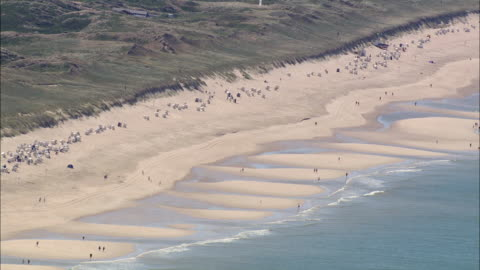 ms aerial view of seashore and people enjoying on seashore / sylt, schleswig-holstein, germany - nordsee stock-videos und b-roll-filmmaterial