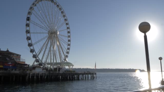 view of seattle great wheel and elliott bay, seattle, washington state, united states of america, north america - elliott bay stock videos & royalty-free footage