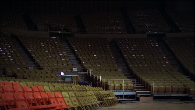 ms view of section of empty seats in forum basketball gymnasium - turnhalle stock-videos und b-roll-filmmaterial
