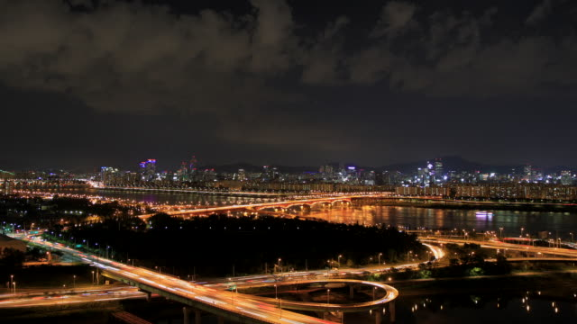 ws t/l zi view of seongsudaegyo bridge and forest at night / suwon, gyeonggi-do, south korea - suwon stock videos and b-roll footage