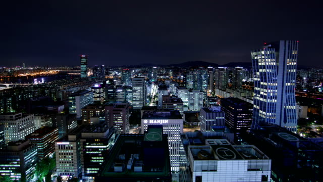 vídeos de stock, filmes e b-roll de view of seoul city and 63 building (remain the tallest skyscraper in korea until 2009) at night - helicopter landing pads