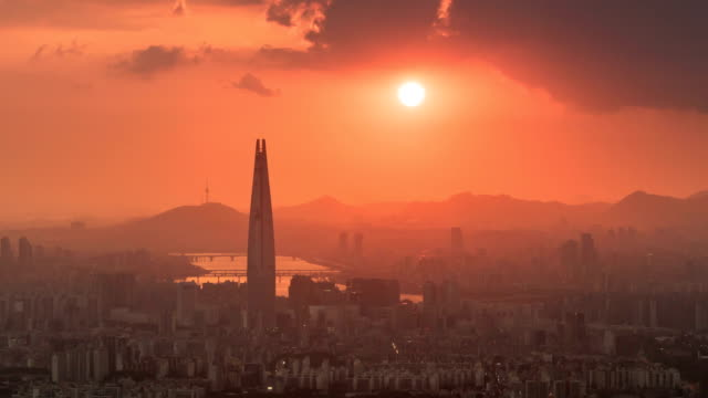 view of seoul city and lotte world tower(tallest skyscraper in korea) in jamsil area at sunset - moving down stock videos & royalty-free footage