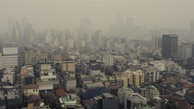view of seoul city (residential area) covered in fine dust and yellow dust - luftverschmutzung stock-videos und b-roll-filmmaterial