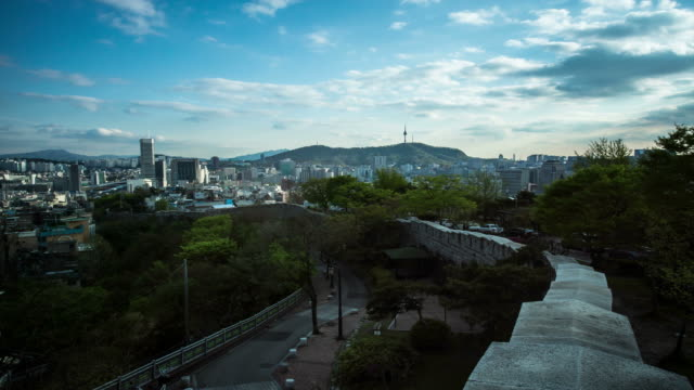 view of seoul over stone wall in nakasan park (famous tourist attraction) - stone wall stock videos and b-roll footage