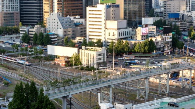 view of seoullo 7017 (the first pedestrian road established recently in elevated road) near western part of seoul station in jung-gu - western script stock-videos und b-roll-filmmaterial