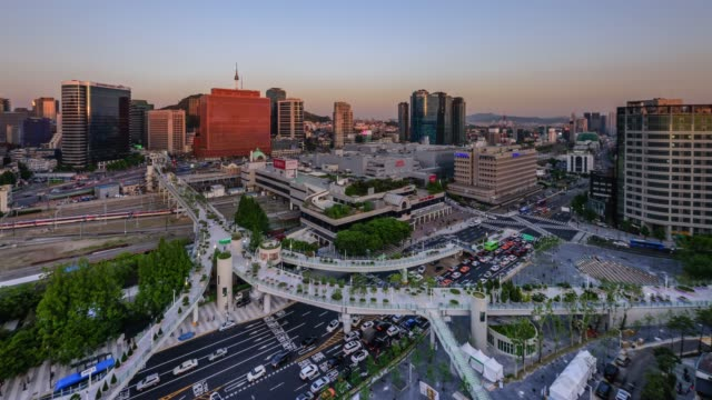 view of seoullo7017(pedestrian walking road) and seoul station at day to night in seoul, south korea - part of vehicle stock videos & royalty-free footage