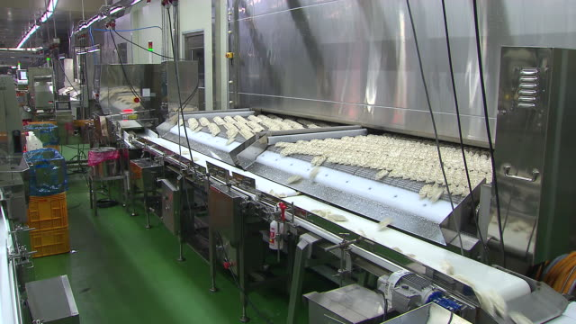 View of separating dumplings into different line of conveyor