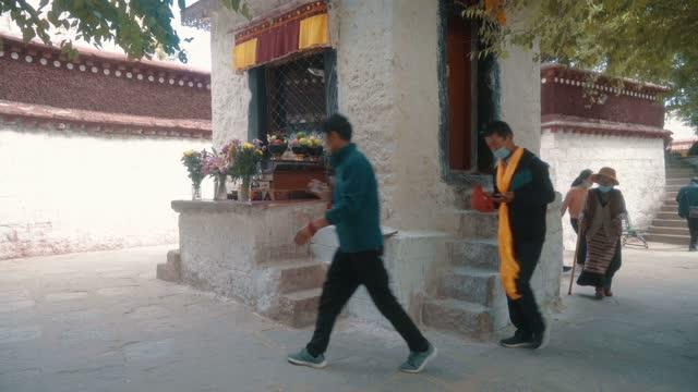 view of sera temple,lsahatibet,china. - traditionally tibetan stock videos & royalty-free footage