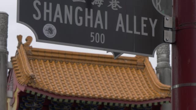 view of shanghai street sign in chinatown vancouver british columbia canada north america - street name sign stock-videos und b-roll-filmmaterial