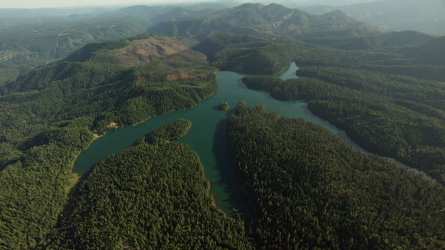 ws aerial pov view of shasta‰ûòtrinity national forest and iron canyon dam with mountain in background / california, united states  - reservoir stock videos and b-roll footage