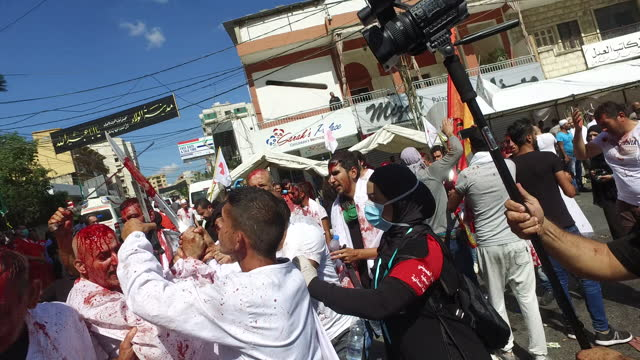 view of shia devotees clanking swords and covered in blood and chanting haydar while performing tatbir, an act of mourning which includes striking... - ashura muharram stock videos & royalty-free footage