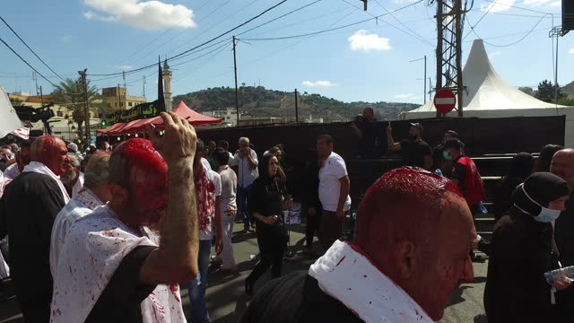view of shia devotees covered in blood and chanting haydar while performing tatbir, an act of mourning which includes striking oneself with a sword... - ashura muharram stock videos & royalty-free footage