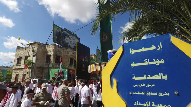 view of shia devotees performing tatbir, an act of mourning at the ashura commemorations organised by hezbollah in nabatieh. ashura is the 10th day... - ashura muharram stock videos & royalty-free footage