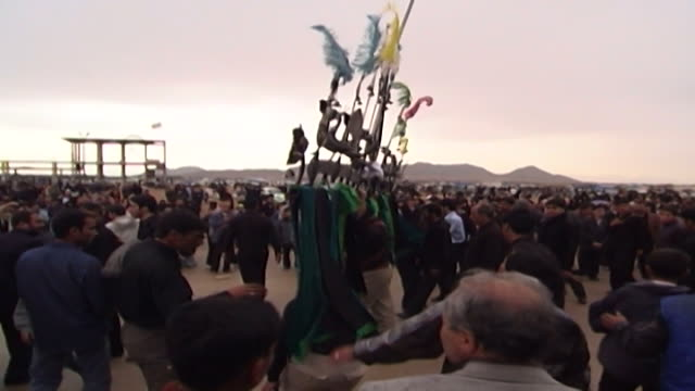 view of shia men carrying a ceremonial construction called an allams during ashura at a mosque in isfahan province ashura the tenth day of the... - karbala stock videos & royalty-free footage