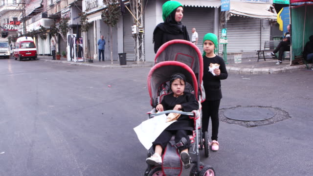 view of shiite mother with her children on a street in nabatieh during ashura ashura is the 10th day of muharram commemorating the martyrdom of... - ashura muharram stock videos & royalty-free footage