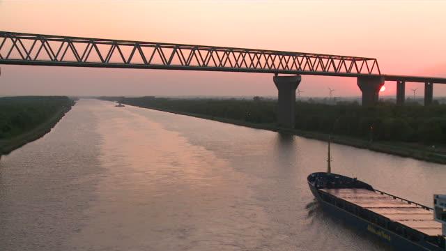 ms pov view of ship in kiel canal at sunrise / brunsbã¼ttel, schleswig-holstein, germany - schleswig holstein stock-videos und b-roll-filmmaterial