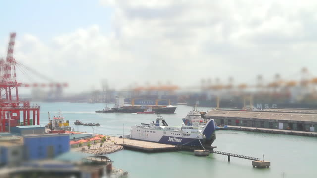 WS T/L View of ships and boats zip around Colombo Port / Colombo, Western Province, Sri Lanka