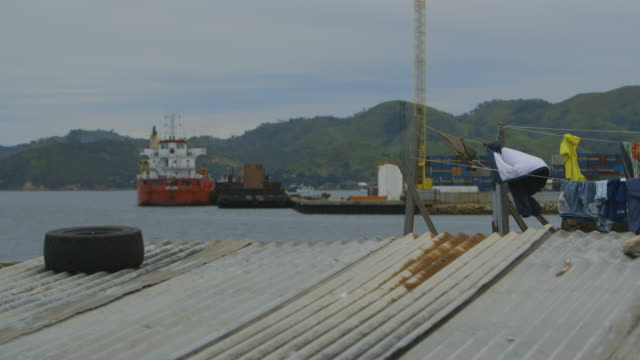 view of ships from a floating village, moresby - stilt house stock videos & royalty-free footage