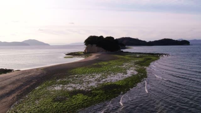 view of shodoshima angel road beach in takamatsu, kagawa, japan - ängel bildbanksvideor och videomaterial från bakom kulisserna