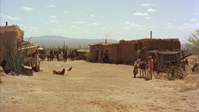 WS view of  shooting down center of road through Mexican adobe village.