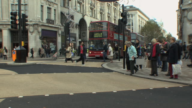 ws view of shoppers and street traffic on oxford street / london, uk.  - western script stock videos & royalty-free footage