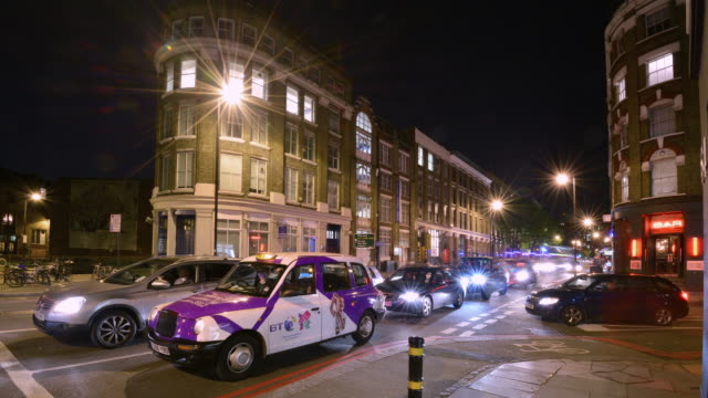 WS T/L View of Shoreditch night time heavy traffic at junction / London, Greater London, United Kingdom