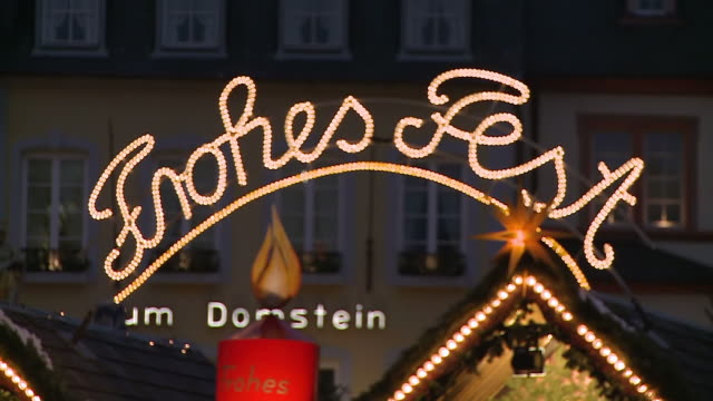 ms r/f view of sign in lights / trier, rhineland-palatinate, germany - フェードアウト点の映像素材/bロール