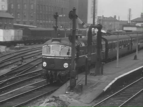 ms pan view of signal box with man pulling levers passing tokens / rubery, worcestershire, england - railway signal stock videos & royalty-free footage