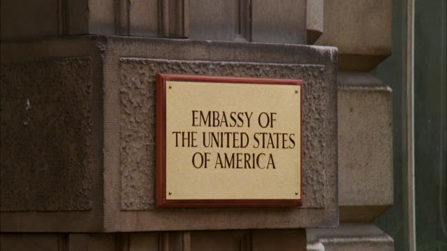 cu view of signboard on building  / frace - us embassy stock videos & royalty-free footage