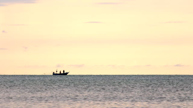 View of Silhouette fishing boat in the sea at morning, tranquil scene