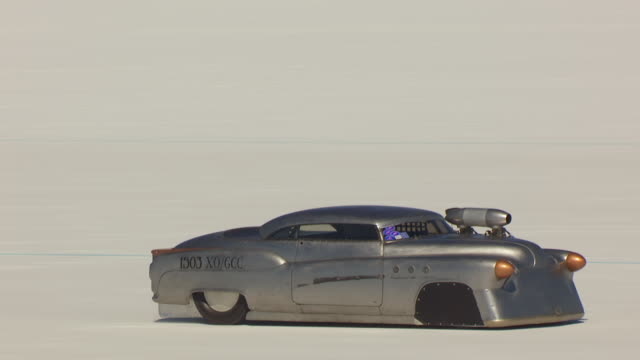 cu aerial ts zo view of silver grey motorcycle rocket at start line and races at bonneville salt flats during speed week / utah, united states - bonneville salt flats stock videos and b-roll footage